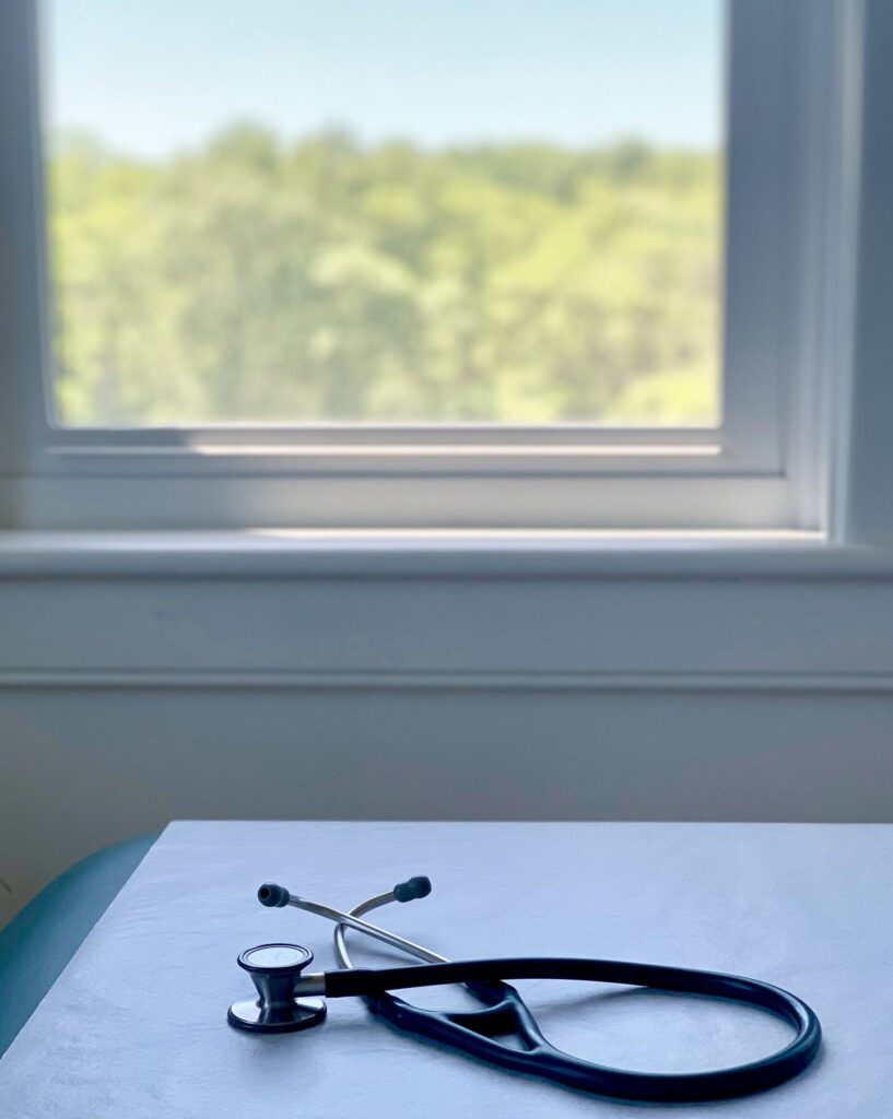 Stethoscope by window covid pic